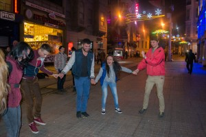 Dancing with some strangers in the street.