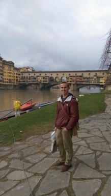 Standing by the docks of the Florence Boathouse