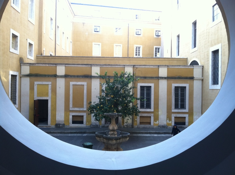 5. with a view of the interior courtyard. Kids played football underneath an orange tree.