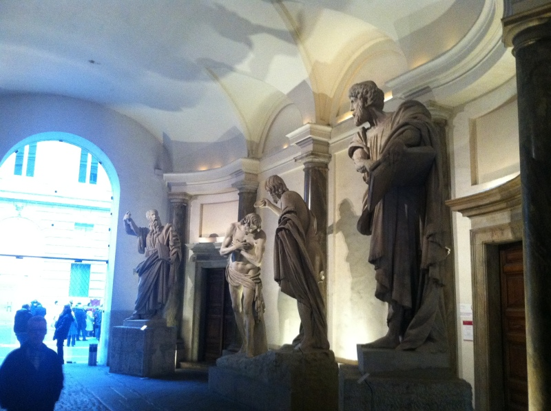 7. four massive and imposing statues.