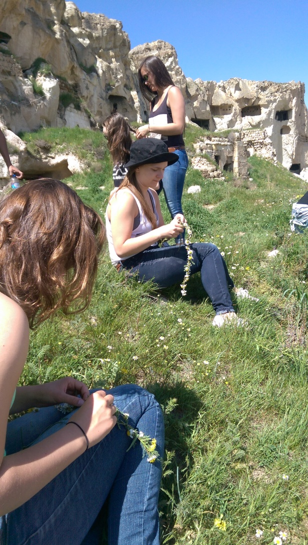 After climbing for a while we stopped in a patch of grass and daises on a ledge to enjoy the view, the sun and the art of flower crown making.