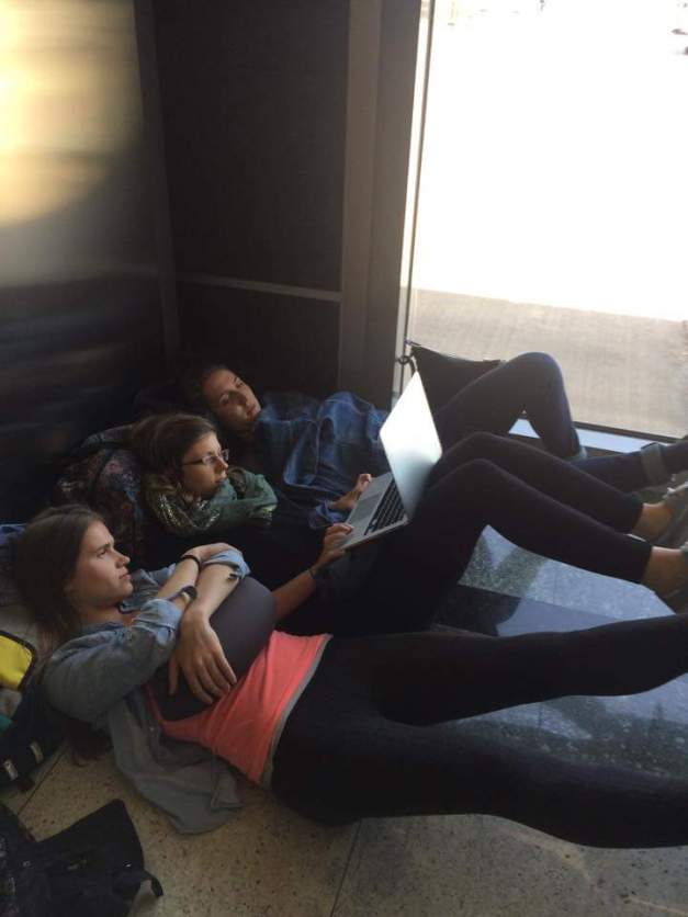 Watching movies on the floor of the Istanbul airport during our 6 hour layover