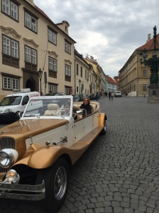 An old fancy vehicle passing by us on the street